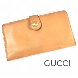 Vintage Authentic Gucci tan leather bifold wallet
